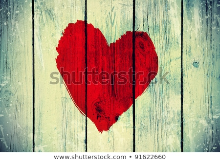 Foto stock: love symbol on old wooden wall