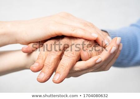 senior and young holding hands stock photo © melpomene