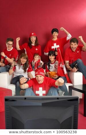 futebol · fãs · vermelho · sessão · sofá - foto stock © sumners