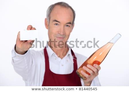 senior wine waiter showing businesscard stock photo © photography33