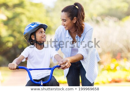 Stock photo: pretty boy on a bicycle outside