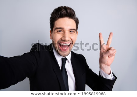 man shows victory sign stock photo © feedough