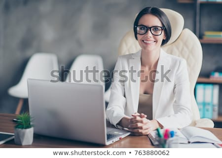 Young banker in front of a computer Stock photo © photography33