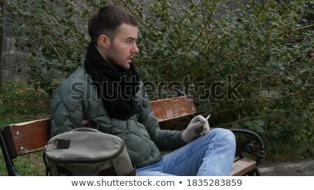 Dorosły bum palenia człowiek 30 lat Zdjęcia stock © eldadcarin