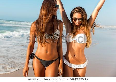 улыбаясь · женщины · солнечные · ванны · пляж · желудка · морем - Сток-фото © dolgachov