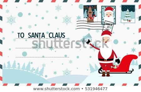 envelope with Santas hat Stock photo © alexmillos