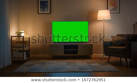 Photo stock: Tv Set On The Wall In Dark Room