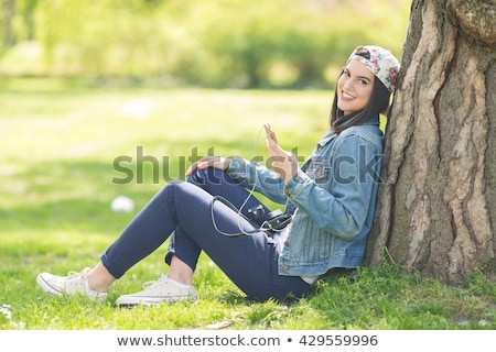 Teenage girl using mp3 player outdoors Stock photo © monkey_business