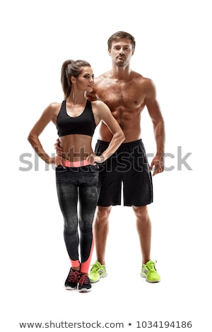 Athletic couple - man and woman with dumbbells on the white Stock photo © vlad_star