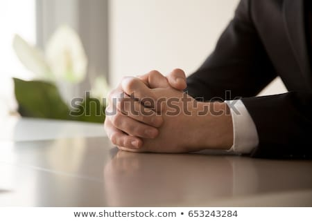 Calm businessman with clasped hands Stock photo © stockyimages