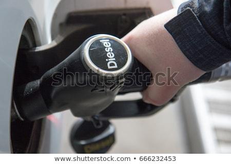 coche · gasolinera · noche · primer · plano · petróleo - foto stock © yongkiet