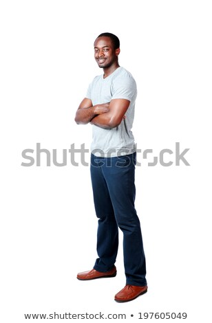 cheerful african man standing with arms folded over white background stock photo © deandrobot