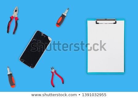 broken phones and clippers  Stock photo © OleksandrO