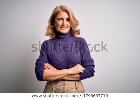 fashionable woman standing arms crossed over white background stock photo © andreypopov