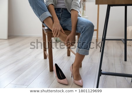 business woman taking off shoes stock photo © hasloo