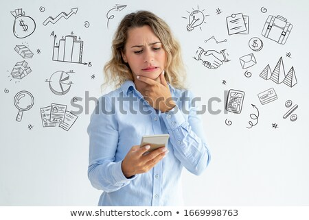 disappointed woman making grimaces to phone Stock photo © Giulio_Fornasar