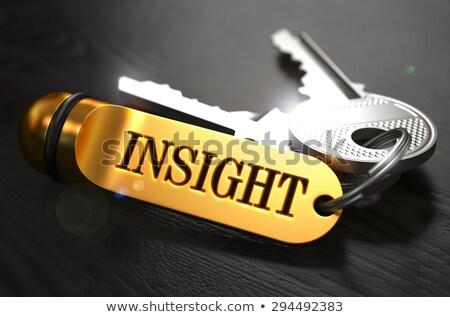 Sleutels woord inzicht gouden label zwarte Stockfoto © tashatuvango