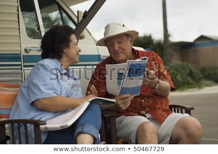 Mujer lectura revista tumbona retrato cute Foto stock © deandrobot