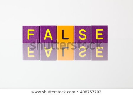 False - an inscription from children's blocks Stock photo © CaptureLight