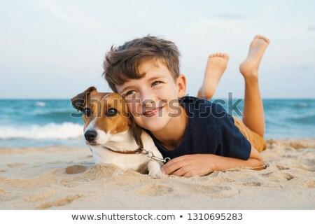 Zdjęcia stock: Boy Hugging His Dog