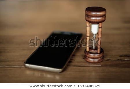 hourglass on wooden table stock photo © fuzzbones0