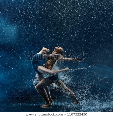 Stock fotó: Young Beauty Dancing With Water Splash