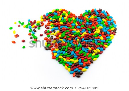 Stock photo: Abstract heart from colored chocolate candy in multicolored glaz