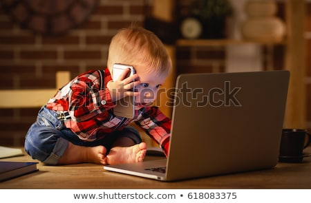 Young boy working on computer. stock photo © gregepperson