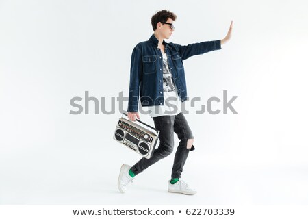 Handsome young man holding boombox. Looking aside. Stock photo © deandrobot