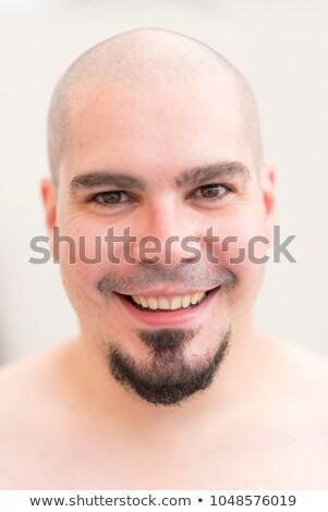 Smiling Caucasian Man Shaved Head Goatee Isolated stock photo © Qingwa