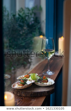 white wine salad of snack are served on a table at restaurant stock photo © yatsenko