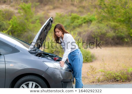 Stock photo: Woman calling car repair service from counrty road