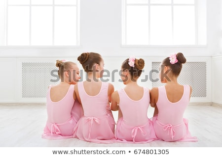 young pretty ballet dancer sitting in elegant pose back view stock photo © julenochek