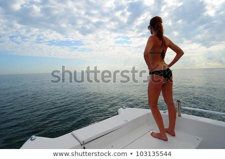 Felice donna bikini costume da bagno blu mare Foto d'archivio © dolgachov