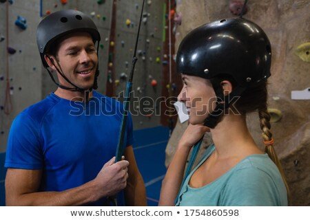 smiling athletes in sports helmet standing at health club stock photo © wavebreak_media