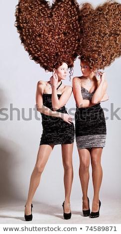 Nina hermosa alto rizado peinado Foto stock © svetography
