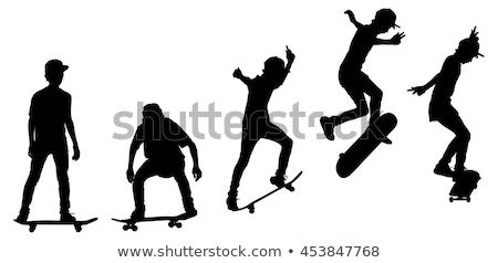 силуэта скейтбордист прыжки трюк икона ног Сток-фото © Olena