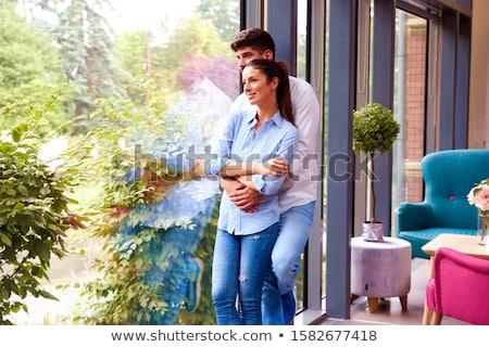 Foto d'archivio: Couple Standing At Window