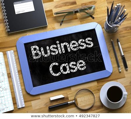 Business Cases - Text on Small Chalkboard. 3D. Stock photo © tashatuvango