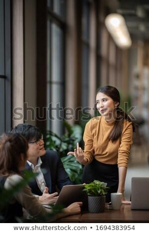 Stałego tabeli kobieta biuro człowiek Zdjęcia stock © IS2