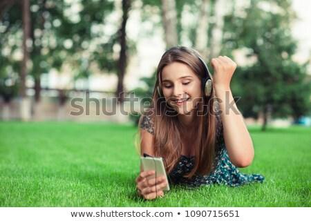 Egy nő fejhallgató nő zene technológia jókedv Stock fotó © IS2