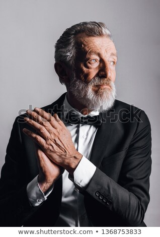 Close up portrait of a man dressed in tuxedo Stock photo © deandrobot