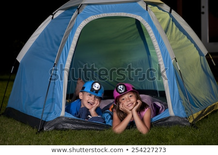 Family lying down in front of tent Stock photo © IS2
