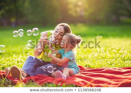 Apa fia buborékfújás együtt baba szeretet jókedv Stock fotó © IS2