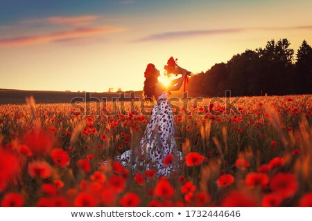 beauty girl silhouette with red poppy Stock photo © ESSL