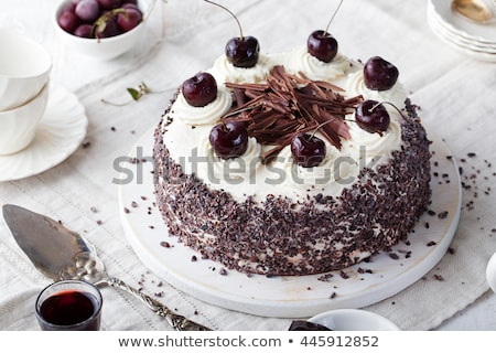 piece of delicious cake with berries and whipped cream on wooden board  Stock photo © LightFieldStudios