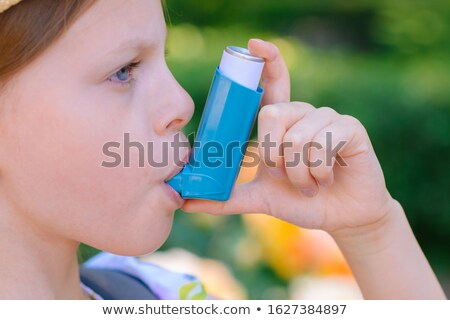 Woman Using Asthma Inhaler Stock photo © AndreyPopov