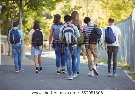 Achteraanzicht school kinderen lopen weg campus Stockfoto © wavebreak_media