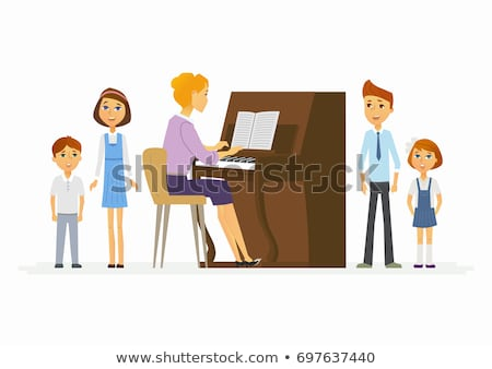 Teacher with schoolboy playing piano in music class Stock photo © monkey_business