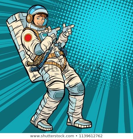 astronaut young man points stock photo © studiostoks
